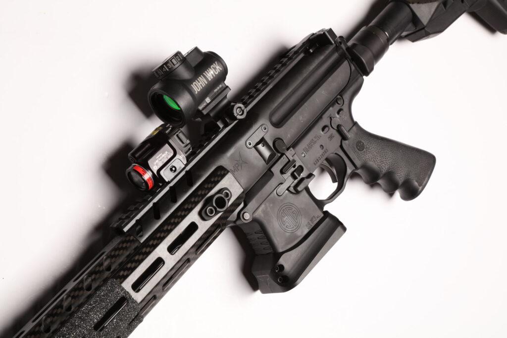 UN12 Magazine John Wick III Vault Taran Tactical SIG MPX PPC Left Side Lower Close up
